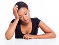 Sad african woman american sitting at a desk on white background Royalty Free Stock Image