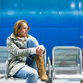 Sad and alone in a big city depressed young woman sitting metro station feeling sorrow regret Royalty Free Stock Image