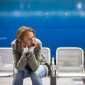 Sad and alone in a big city depressed young woman sitting metro station feeling sorrow regret Stock Photos
