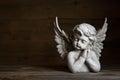 Sad angel: idea for a greeting or condolence card. Royalty Free Stock Photo