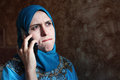 Sad arab muslim businesswoman with mobile Royalty Free Stock Photo