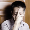 Sad asian man Royalty Free Stock Images
