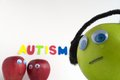 Sad autism apple the red apples are grouped together talking about the green because it is different the red apples are focused Royalty Free Stock Photos