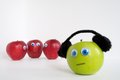 Sad autism apple series the red apples are grouped together talking about the green because it is different the red apples are Stock Photos