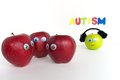 Sad autism apple series the red apples are grouped together talking about the green because it is different the red apples are Stock Photo