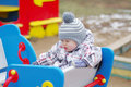 Sad baby on playground age of year sitting Royalty Free Stock Photos