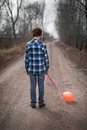The sad boy with a balloon on road Royalty Free Stock Images