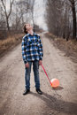 The sad boy with a balloon on road Stock Image