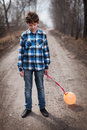 The sad boy with a balloon on road Stock Images
