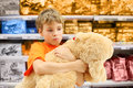 Sad boy hugs yellow dog toy Stock Photos
