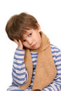 The sad boy with a scarf holds head Royalty Free Stock Image