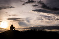 Sad boy silhouette worried on the meadow at sunset ,Silhouette c Royalty Free Stock Photo