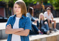 Sad boy teenager standing lonely outdoors Royalty Free Stock Photo