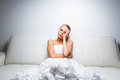 Sad bride crying sitting on a sofa Royalty Free Stock Photo
