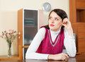 Sad brunette woman at home Royalty Free Stock Images