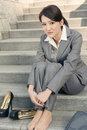 Sad business woman feel helpless and sit on stairs in modern city Royalty Free Stock Image