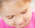 Sad child face close-up. Child looking down. Royalty Free Stock Images