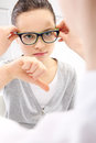 Sad child with glasses portrait of a girl at an ophthalmologist Stock Images