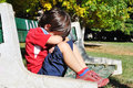 Sad child in the park, outdoor Stock Image