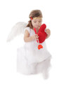 Sad cupid girl sitting with heart Royalty Free Stock Photo