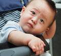 Sad cute asian baby watching out from car Royalty Free Stock Photos