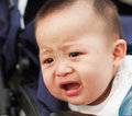 Sad cute asian baby watching out from car Stock Images