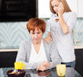 Sad daughter with mother grief women at home Stock Photography