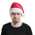 Sad face man with a santa hat isolated on white Stock Photography