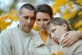 Sad family of three on the nature Royalty Free Stock Photo