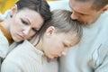 Sad Family Of Three On The Nat...