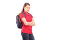 A sad female teenager with a backpack isolated on white background Royalty Free Stock Image