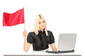 Sad female worker waving a flag Royalty Free Stock Photos