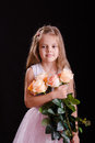 Sad five year old girl with a bouquet of flowers Royalty Free Stock Photo