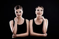 Sad and funny mimes sisters twins on black background Stock Photo