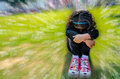 Sad girl child in the park with bokeh and in focus Stock Photography