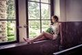 Sad girl near a window Royalty Free Stock Photo