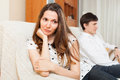 Sad girl during quarrel women with boyfriend at home Royalty Free Stock Images