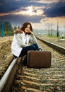 Sad girl on  railway Stock Photo