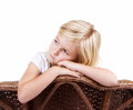 Sad girl sitting in chair little with a or lonely look on her face isolated on white background Royalty Free Stock Photos