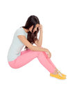 Sad girl sitting on the floor isolated white background Royalty Free Stock Photography
