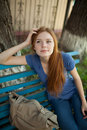 Sad girl sitting on a park bench Royalty Free Stock Images
