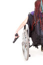 Sad girl on wheelchair with gun Royalty Free Stock Images
