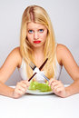 Sad healthy woman with lettuce Royalty Free Stock Photos