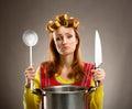 Sad housewife with sause pan Royalty Free Stock Photo