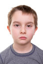 Sad kid having depression that you can see in his eyes shoulders and expression isolated on white Stock Image