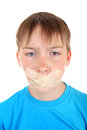 Sad kid with sealed mouth isolated on the white background Royalty Free Stock Photos