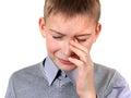 Sad kid weeps on the white background closeup Royalty Free Stock Photos