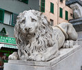 The sad lion genoa italy may stone medieval guardian of entrance to saint lawrence cathedral Stock Photo