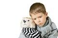 Sad Little Boy Hugging Toy Dog...