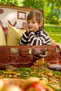 Sad little boy sitting in an old suitcase Royalty Free Stock Image